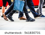 feet of pedestrians walking on... | Shutterstock . vector #561830731