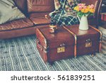 Vase of flowers on a vintage coffee table. - stock photo