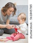 nine months old baby girl...   Shutterstock . vector #561845785