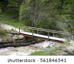 wooden bridge over a small...