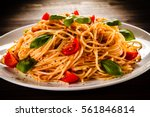 pasta with meat  tomato sauce... | Shutterstock . vector #561846814