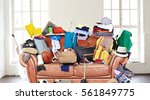 large leather sofa with a bunch ... | Shutterstock . vector #561849775