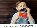 a kid with props for a photo... | Shutterstock . vector #561856879