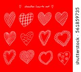 set of hand drawn doodle hearts.... | Shutterstock .eps vector #561859735