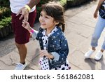 family father daughter holding... | Shutterstock . vector #561862081