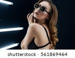 sexy girl posing in studio... | Shutterstock . vector #561869464