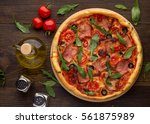 homemade pizza with ham ... | Shutterstock . vector #561875989