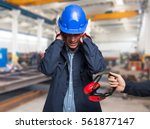 worker protecting his ears from ...   Shutterstock . vector #561877147