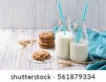 bottles of milk with blue...   Shutterstock . vector #561879334