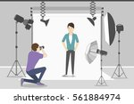 male model in photo studio.... | Shutterstock .eps vector #561884974