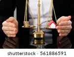 female lawyer protecting...   Shutterstock . vector #561886591