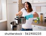 shocked woman calling plumber... | Shutterstock . vector #561900235
