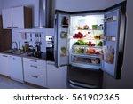 open refrigerator full of... | Shutterstock . vector #561902365
