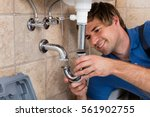young male plumber fitting sink ... | Shutterstock . vector #561902755