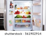 open refrigerator filled with... | Shutterstock . vector #561902914