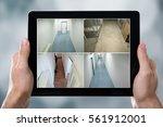 person monitoring cameras live... | Shutterstock . vector #561912001