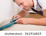 close up of a young handyman...   Shutterstock . vector #561916819