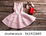 red purse with salmon dress....   Shutterstock . vector #561922885