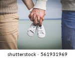 female and male expecting a... | Shutterstock . vector #561931969