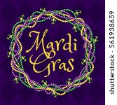 mardi gras purple background... | Shutterstock .eps vector #561938659
