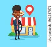 african american man holding...   Shutterstock .eps vector #561987571