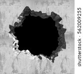 explosion hole in concrete... | Shutterstock . vector #562009255