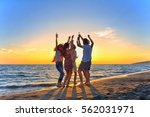 group of happy young people... | Shutterstock . vector #562031971