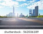 asphalt road and modern city | Shutterstock . vector #562036189