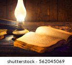 Old Oil Lamp And Old Books In...