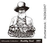 farmer holding a basket of...   Shutterstock .eps vector #562061047