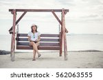 beautiful young woman sat on a... | Shutterstock . vector #562063555