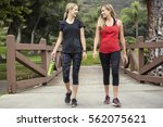 two attractive women in their... | Shutterstock . vector #562075621