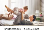 happy loving family. young... | Shutterstock . vector #562126525