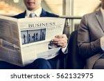 business men break sit read... | Shutterstock . vector #562132975