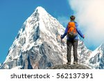 hiker with backpacks reaches... | Shutterstock . vector #562137391