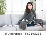 young woman feeling sick or sad ... | Shutterstock . vector #562143211