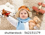 happy child boy playing with... | Shutterstock . vector #562151179