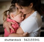 mother and daughter embracing... | Shutterstock . vector #562155541