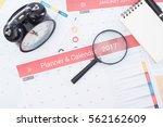 magnifier and business calender ... | Shutterstock . vector #562162609