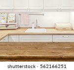 blurred kitchen interior with... | Shutterstock . vector #562166251