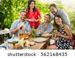 group of friends gathered... | Shutterstock . vector #562168435