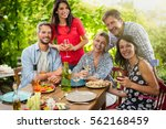 group of friends gathered... | Shutterstock . vector #562168459