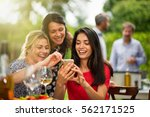 group of female friends in... | Shutterstock . vector #562171525