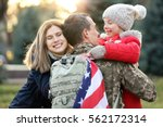 usa soldier hugging his family... | Shutterstock . vector #562172314