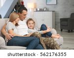 military father with his family ... | Shutterstock . vector #562176355
