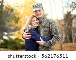 soldier in camouflage hugging... | Shutterstock . vector #562176511