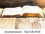 open bible with burred page on... | Shutterstock . vector #562181935