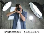 Young Male Photographer In...