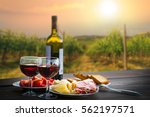 still life red wine  cheese and ... | Shutterstock . vector #562197571