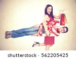 woman buys funny man for... | Shutterstock . vector #562205425